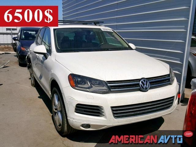 Купить белую бу VOLKSWAGEN TOUAREG 3.6 2012 года в США